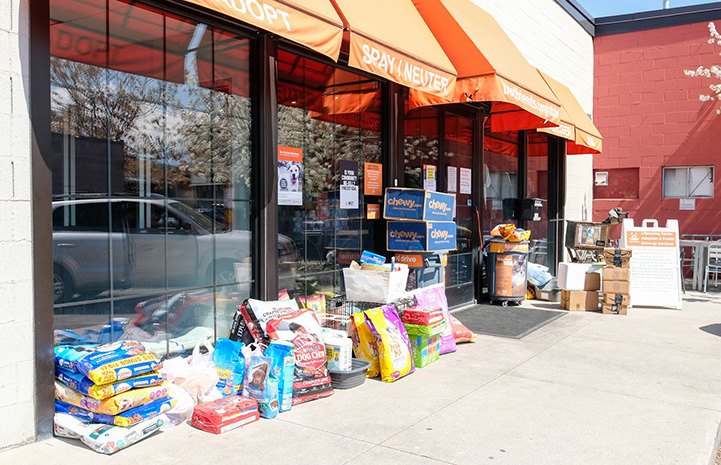 Piles of donated food and supplies placed outside of Best Friends in Salt Lake City