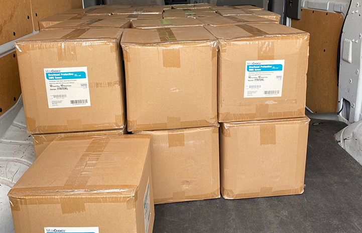 Boxed up medical protective gowns to be donated