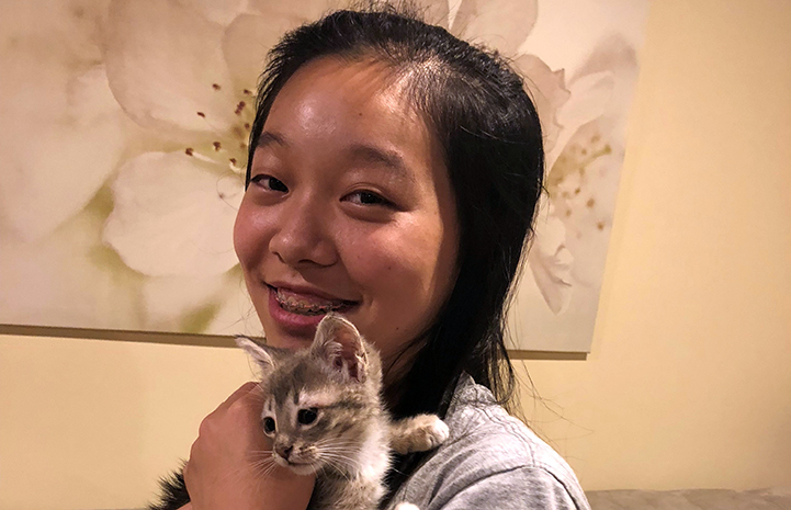 Sherry Xi holding her foster kitten Nassarose