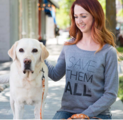 Red haired girl with yellow Labrador retriever