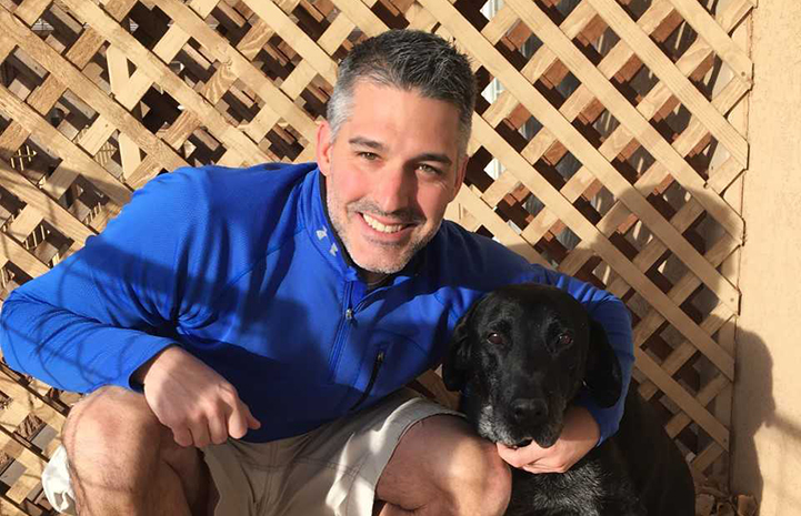 Nuece the dog posing with Doug