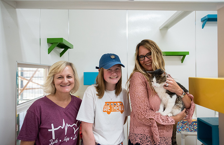 Best Friends CEO Julie Castle holding a cat, while next to Gianna Richason and another woman