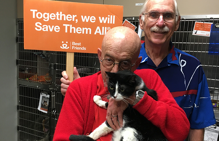 Robb and Jerry adopting Simon the black and white cat