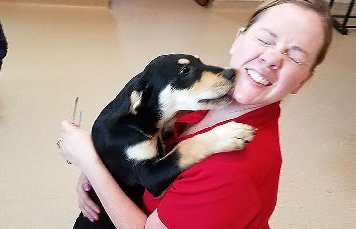 The veterans from Team Red, White & Blue (RWB) got thanks for volunteering with puppy kisses