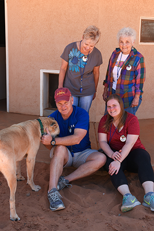 Katie Kramer Kelley with her family volunteering at Best Friends Animal Sanctuary