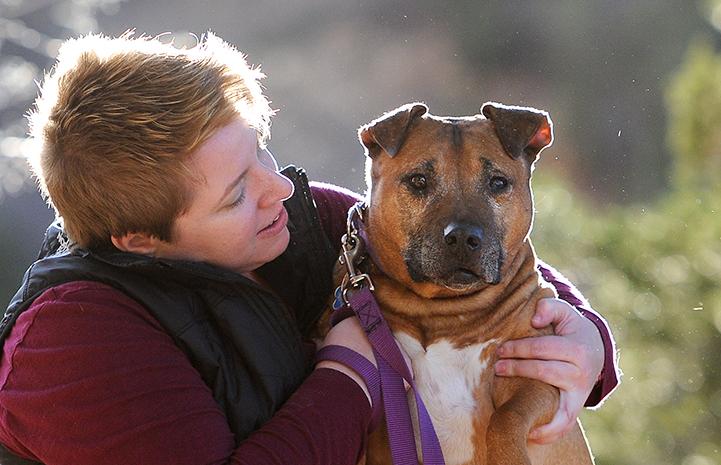 Adopter Rachel Johnson with Oscar the Vicktory dog