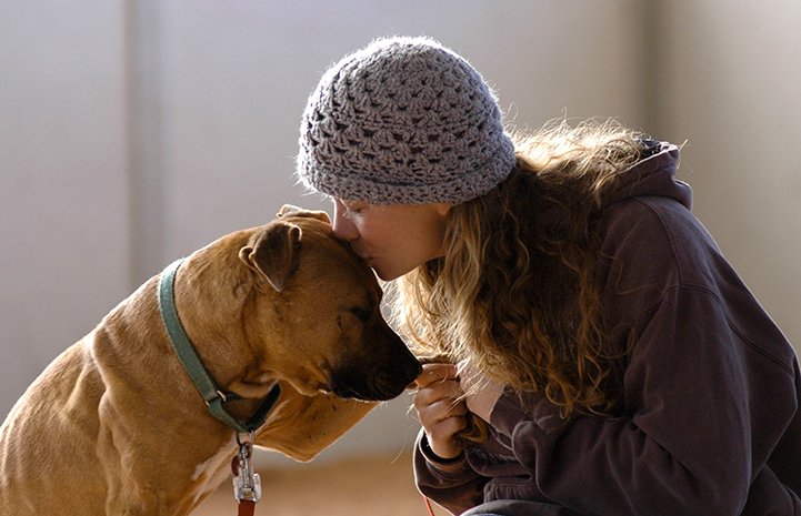 Caregiver Carissa Hendrick with Vicktory dog Oscar