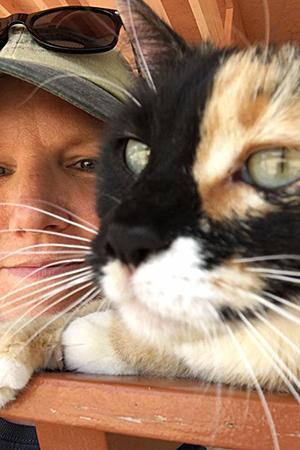 Volunteer Denise Groll helping at Cat World