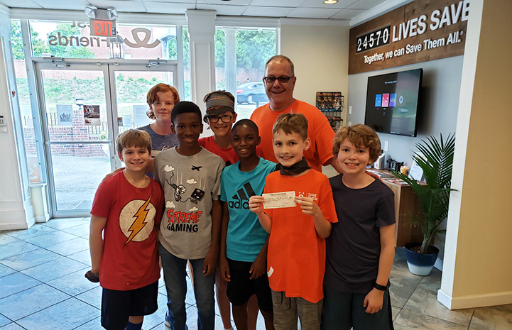 Jack Hallock presenting a check to Best Friends as part of his birthday party