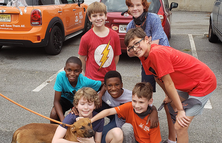 Jack Hallock and his friends posing with a dog