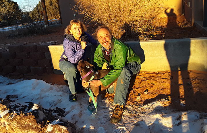 Volunteers Jean and Steve with Hercules the dog, during their sleepover