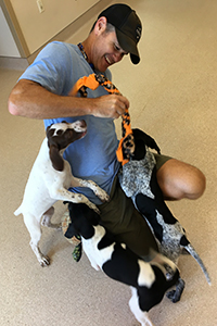 Kevin Wesely helping to socialize puppies at Best Friends Animal Sanctuary