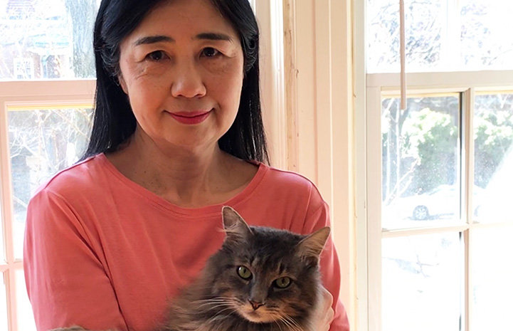 Kyoko Bruguera with foster cat O'Malley