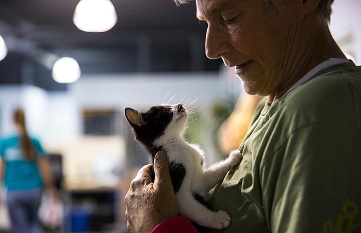 Robin Reddy holding a feline friend