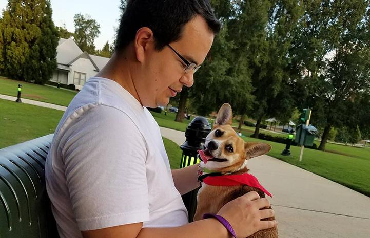Volunteer Eric Granados walking Dolly the dog