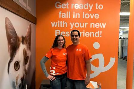 Volunteers Erin and Eric Granados at the Best Friends Pet Adoption Center in Atlanta
