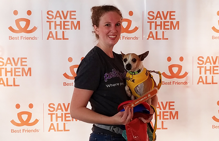 Volunteer Erin Granados holding Dolly Mae the dog from the Best Friends Pet Adoption Center in Atlanta