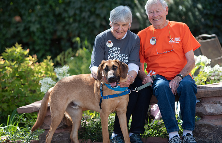 Volunteers Mary Rose and Vann Hollie with Uno the dog