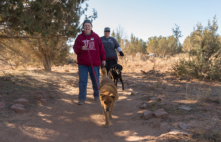 Walking the dogs and playing with the puppies are Mary's favorite things to do when visiting Best Friends