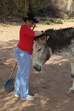 Jennifer Dujka enjoying time volunteering with Speedy the donkey