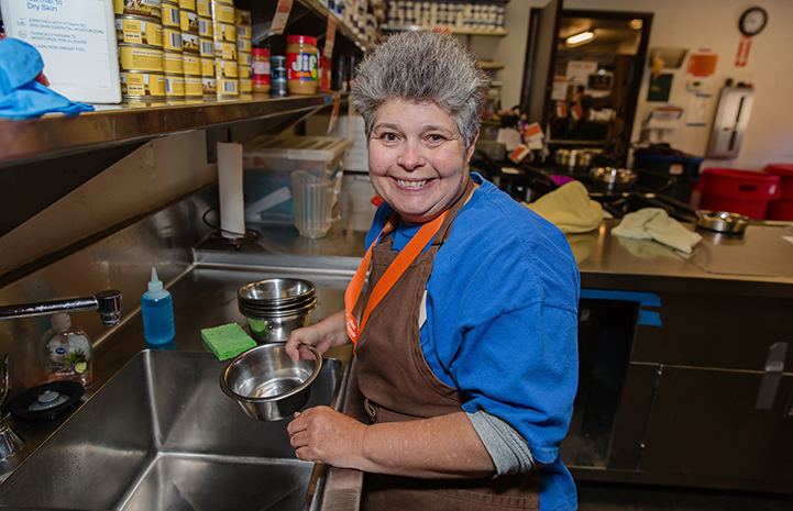 Woman from Tierra Del Sol volunteering to do dishes at the Best Friends Pet Adoption and Spay/Neuter Center in Los Angeles
