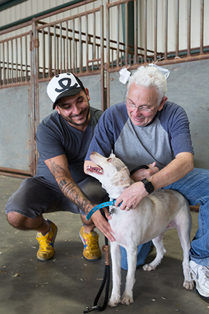 Winston the dog with Tony and Best Friends' Marc Peralta