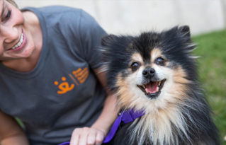 https://bestfriends.org/Woman%20and%20fluffy%20small%20dog%20at%20super%20pet%20adoption%20event.