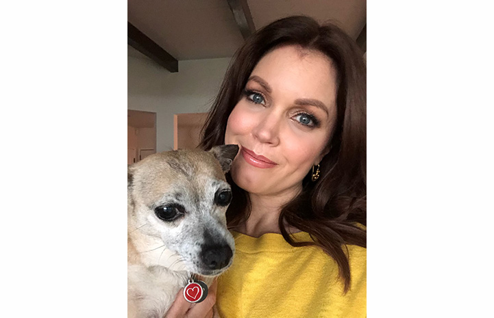 Bellamy Young holding a dog