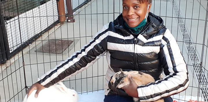 https://bestfriends.org/Volunteer%20sitting%20in%20an%20X-pen%20with%20two%20rabbits