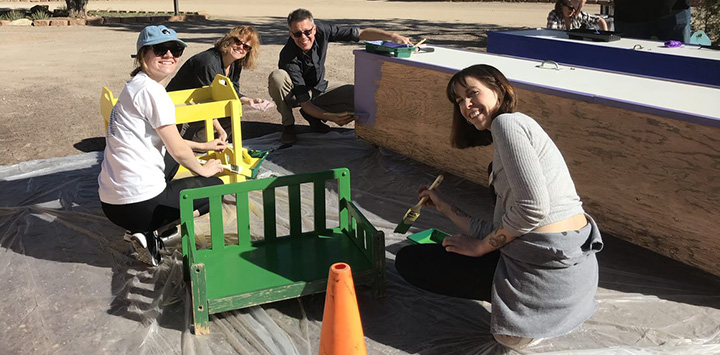 https://bestfriends.org/Group%20of%20volunteers%20painting%20a%20green%20bench