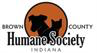 Brown County Humane Society (Nashville, Indiana) logo of dog and cat shadows in an orange circle