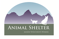 Jackson/Teton County Animal Shelter (Jackson, Wyoming) logo-arch with green bottom, purple mountains & blue sky, a dog and cat