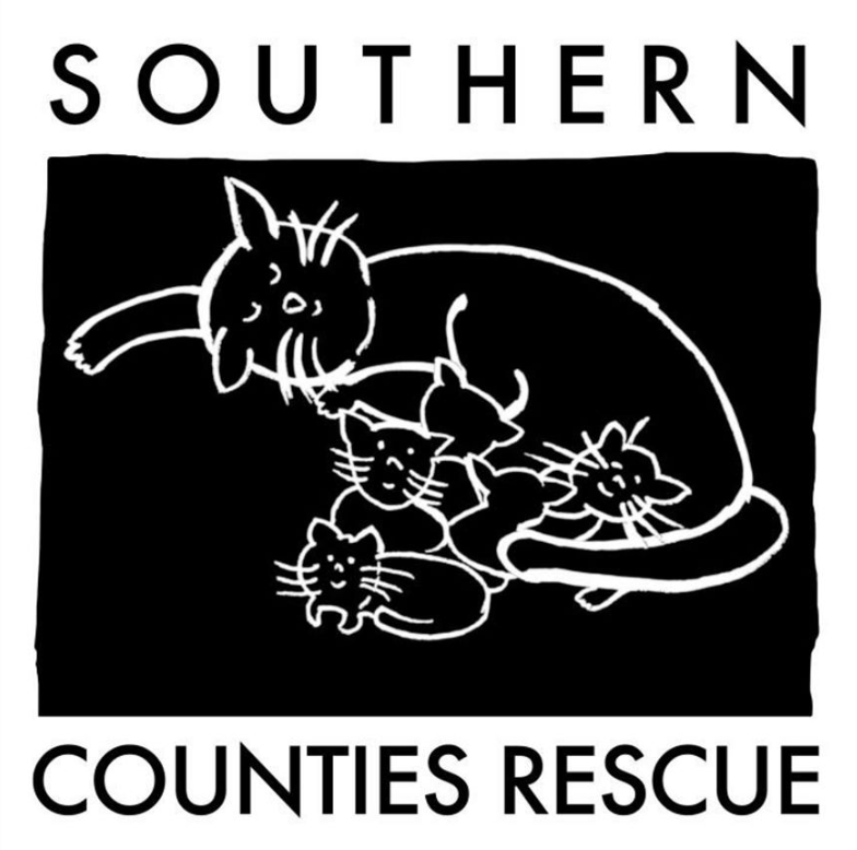 Southern Counties Rescue Inc. (Brawley, California) logo with black background with white cat outlines