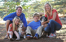 Scharf family posting with two dogs at Best Friends Animal Sanctuary