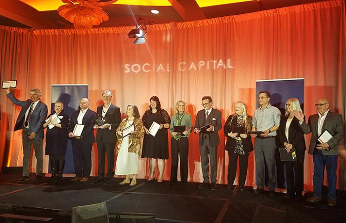 Best Friends co-founders receiving the Social Capital Hero Award honor
