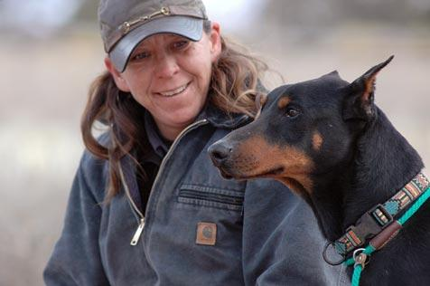 Roofus the Doberman and a woman