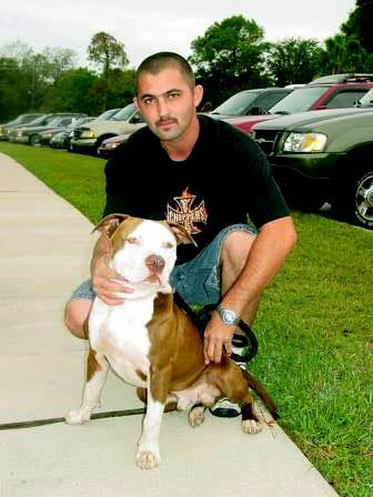 Pit bull mix who is on his way to be neutered and his person