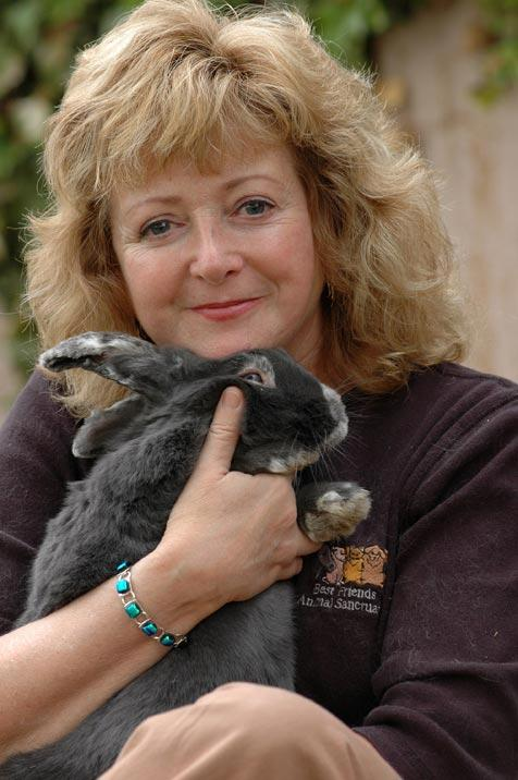Debby holding Buttons the rabbit whom she adopted