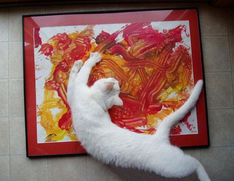 Cat painting art using his paws
