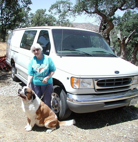 Nancy Johnston standing with her St. Bernard next to the van she donated to Best Friends