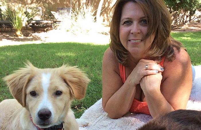 Once abandoned puppy with his adoptive mom