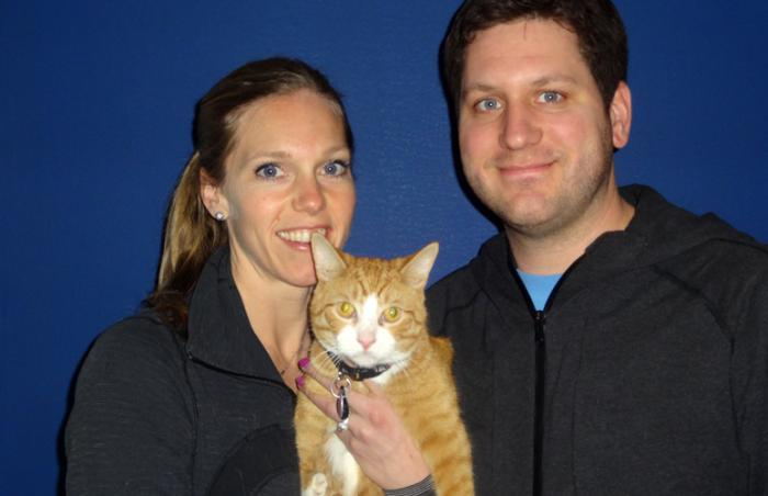 Beazley the cat with short, misshapen front legs fits right in with his new family