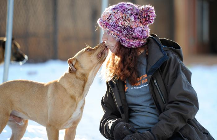 Lakota the dog who was rescued from a dogfighting ring and Caley at the Best Friends Animal Sanctuary