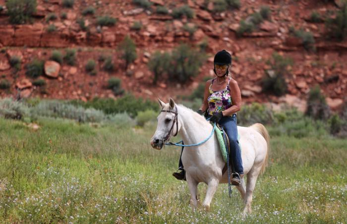 Gracie, a beautiful white horse, and Jackie riding together