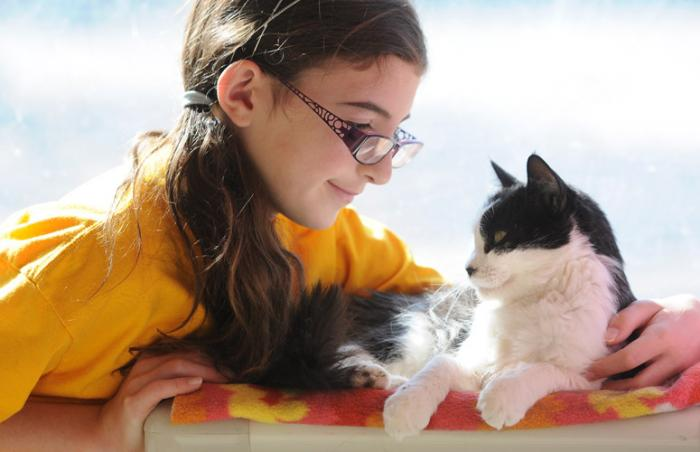 Fifth-grader Riley with Amy the cat