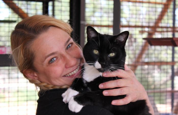 Feline intern Genevieve Hannon with tuxedo cat