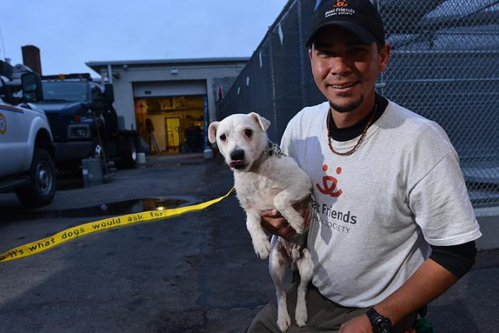John Garcia with dog to be transported