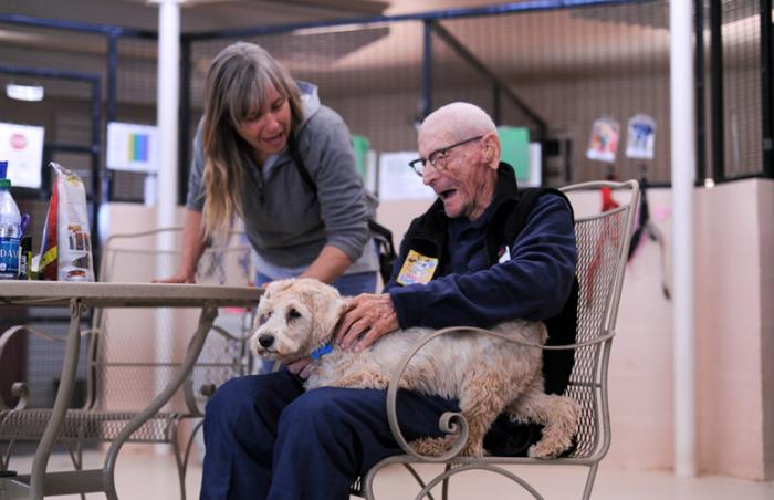 100-year-old Bill Philibert volunteering at Best Friends, socializing a dog