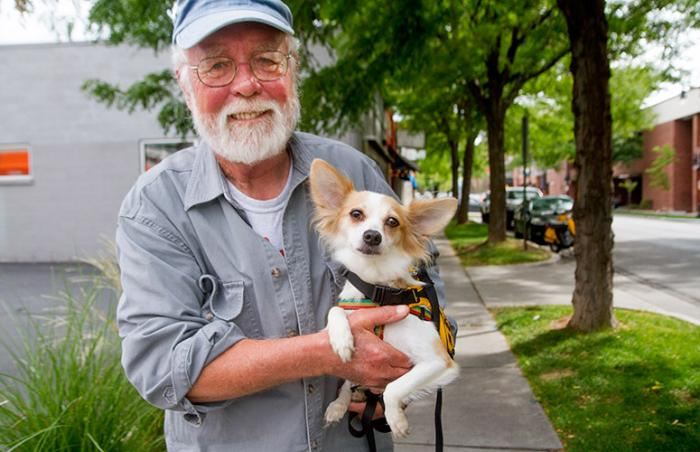 Chuck Austin, who received the  PetSmart Charities Lifetime Volunteer Achievement Award, and Pearl the dog