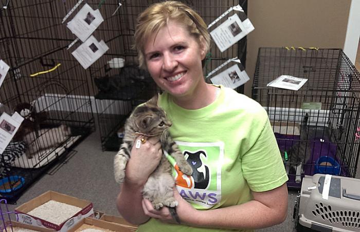 Jaime Carter of Community Animal Welfare Society (CAWS) holding a distemper survivor cat